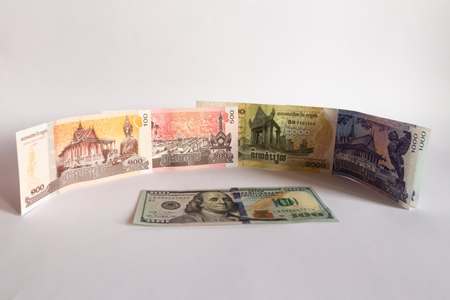 Cambodia riel and dollar banknotes cash isolated on white