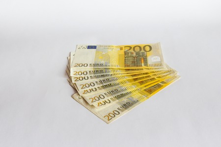 200 Euro bills isolated on white background Фото со стока