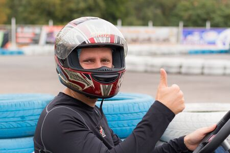 active man in black competing on racing cars at kart circuit