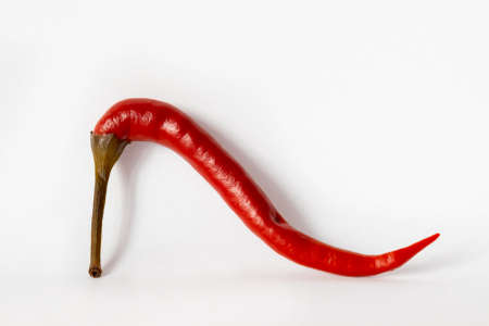 red hot chili peppers look like shoes on a white background isolated