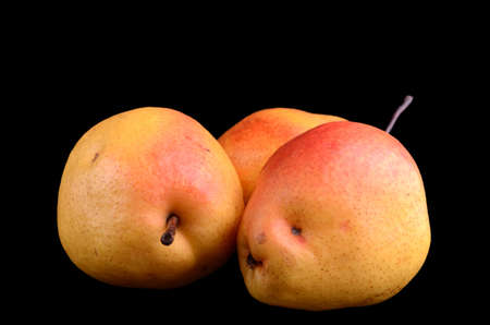 Yellow-red pears isolated on black Stock Photo
