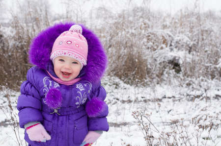 Portrait of happy little girl in snowy landscape Stock Photo - 16800540