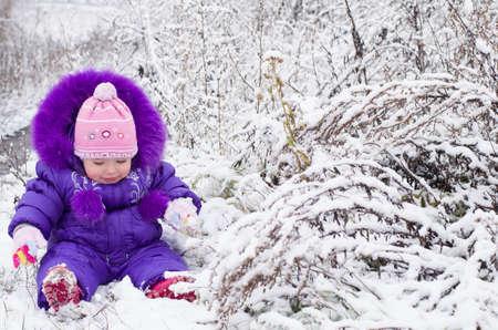 Portrait of happy little girl in snowy landscape Stock Photo - 16800578