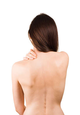 Woman massaging pain back isolated on white