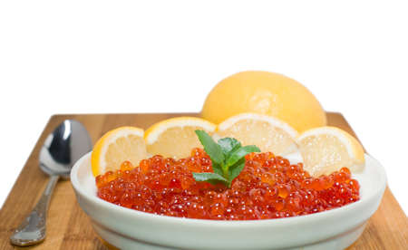 Red caviar on plate with lemon photo