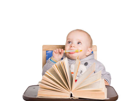 child with a book and pen looks up Stock Photo - 16909129
