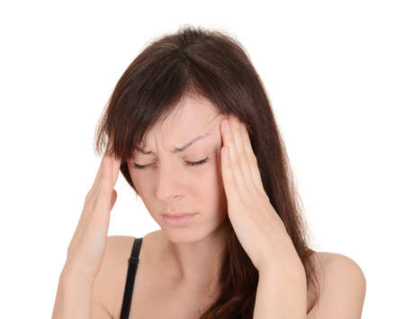 Headache - Young woman holding head in pain isolated on white background Stock Photo
