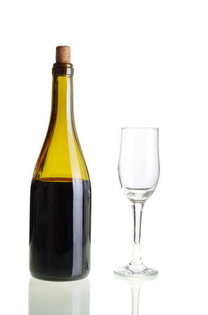 Red wine bottle with empty glass