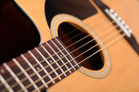 Acoustic guitar with shallow depth of field Stock Photo