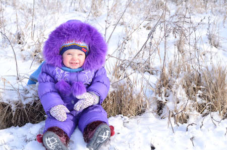 Portrait of happy little girl in snowy landscape Stock Photo - 17622880