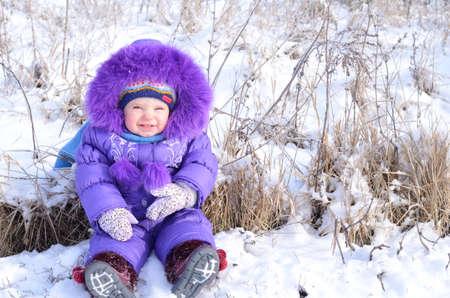Portrait of happy little girl in snowy landscape Stock Photo - 17622880