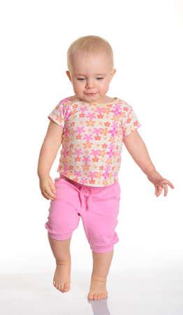 walking baby: Funny baby girl running on white background