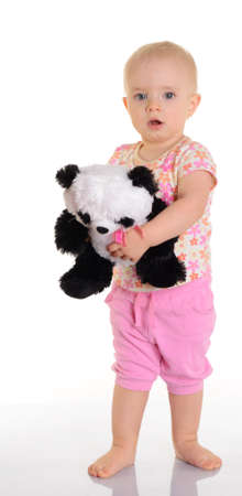 Baby holding plush toy over white background