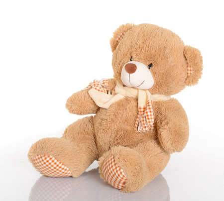 Classic teddy bear with scarf on white background