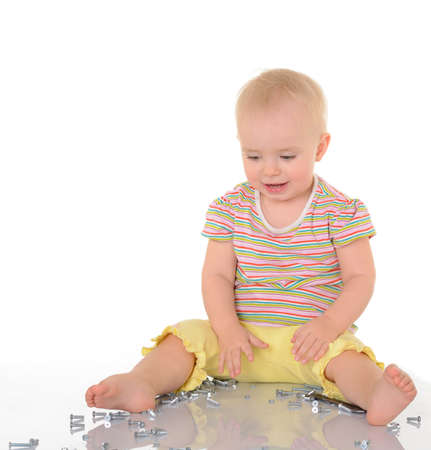 baby with tools on white background Stock Photo
