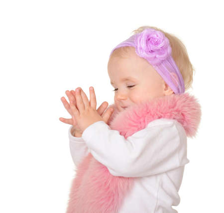 cute baby girl dressed in pink fur play on white background Stock Photo - 17991804