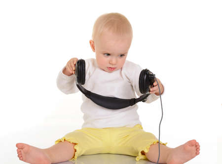 baby  playing with headphones on white background