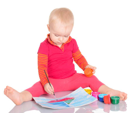 Adorable little girl painting a picture on white background