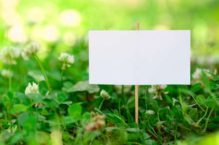 Empty signboard on green grass
