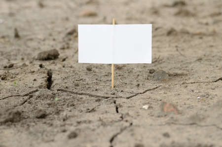 Empty signboard on a cracked ground