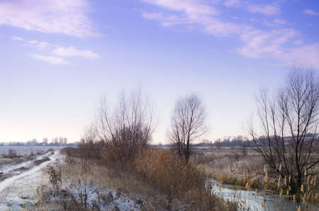 Countryside Winter Road and River, Blue Sky Stock Photo