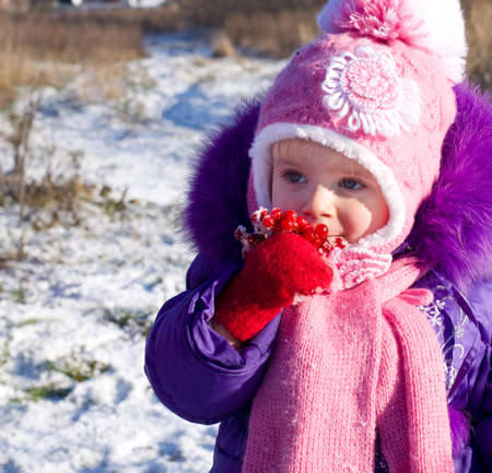 Portrait of happy little girl in snowy landscape Stock Photo