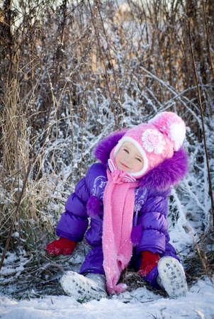Portrait of happy little girl in snowy landscape Stock Photo