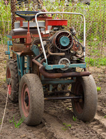 Vintage  Tractor, Ready for Seeding  Stock Photo