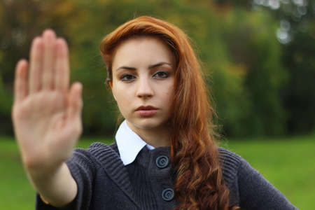 fash: red-haired girl arm symbol