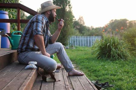 village man: man smoking  pipe at outdoor  village outdoor