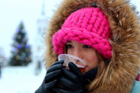beaty: portrait of a girl in the winter drink