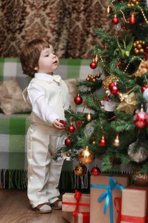 decorating christmas tree: cute boy decorating the Christmas tree