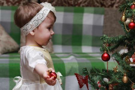 decorating christmas tree: little girl decorating the Christmas tree