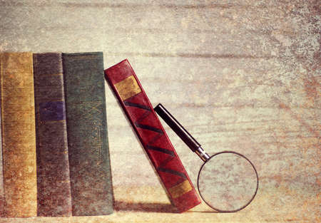 effect photo old book and retro watch on white wooden table