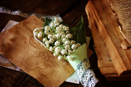 space text: vintage effect on photo bouquet of lilies of the valley and space text