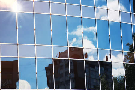 office building: glass office building reflection of sky cloud Stock Photo