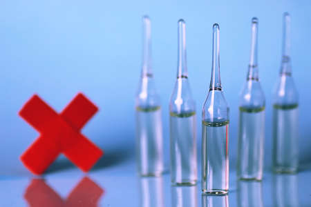 vials: transparent vials of medicine on blue background Stock Photo