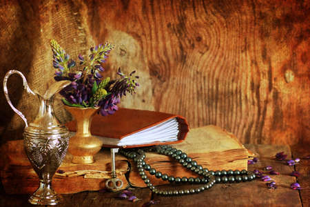 fanaticism: composition with old retro books on a wooden table Stock Photo