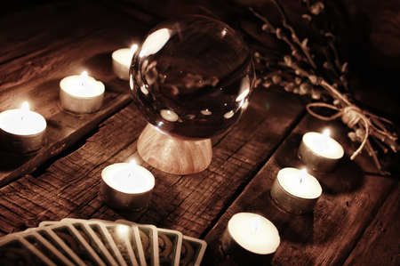 future teller candle and divination tarot cards