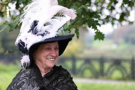 hat with feather: old woman in a hat with feather