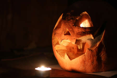 cut pumpkin halloween head in dark evening