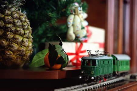 retro train under tree gift christmas objects Stock Photo