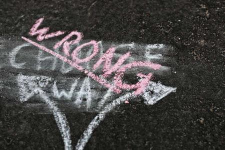 choise: arrows chalk on asphalt concept of hard choise