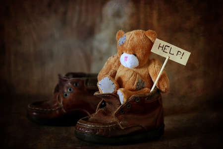 Children nobody help concept with toy bear