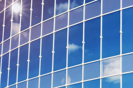 glass reflection: sun light sky cloud reflection in glass office building Stock Photo