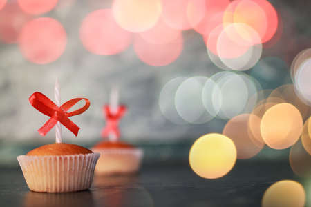 birthday cakes: little delicious cupcake with a candle symbol of celebration events