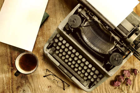 old english: Vintage old English typewriter on the texture wooden sheet of plywood