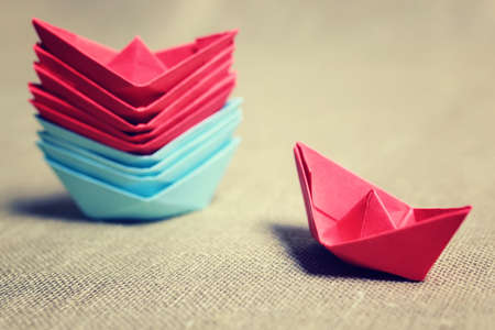 small colored paper folded boat, origami method