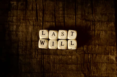 splotchy: small wooden blocks with letters on the old worn wooden table