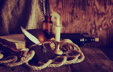 carabineer: Vintage objects on old wooden shabby retro background concept Stock Photo